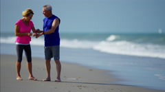 Active senior Caucasian couple enjoying fitness activity by the sea Stock Footage
