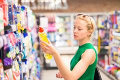 Woman shopping cleaners at supermarket. - stock photo