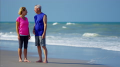 Senior Caucasian couple after fitness activity on the ocean beach Stock Footage