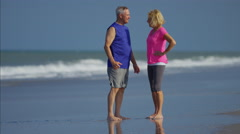 Caucasian seniors enjoying fitness activity on the beach Stock Footage