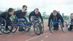 4K Portrait of smiling disabled athletics team in racing wheelchairs.  - stock footage