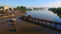 Scenic flight over railroad bridge, train trestle. - stock footage