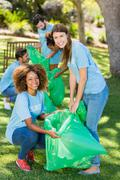 Group of volunteer collecting rubbish in park Stock Photos