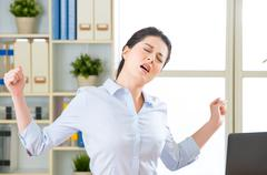 Asian businesswoman fell tired and stretching Stock Photos