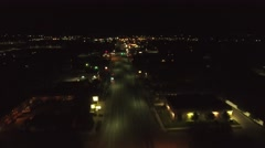 Aerial clip of a rural towns lights late at night Stock Footage