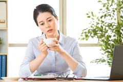Young asian business woman overworked with uncomfortable Stock Photos