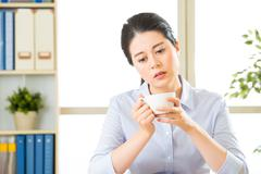 Young asian business woman overworked with uncomfortable - stock photo