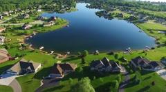 Amazing idyllic rural suburb with beautiful houses on lake. - stock footage