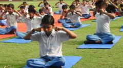 School Children doing yoga in Yoga Classes Stock Footage