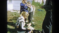 1957: Family harvesting corn ears peeling protective shell away from ears. Stock Footage