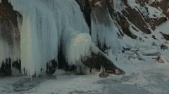 Huge icicles on rocks Stock Footage