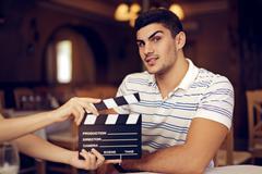 Professional Actor Raising his Eyebrow at the Camera - stock photo