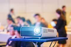 Projector in conference room Stock Photos