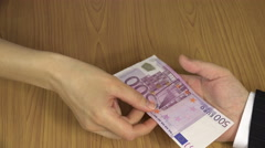 Woman hand give 500 euro cash banknote bribe from envelope. 4K Stock Footage