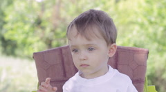 Little boy during feeding spits tasteless food Stock Footage