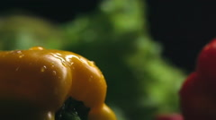 Close up of yellow bell pepper with water droplets on skin - stock footage