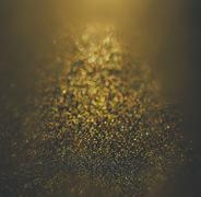 glitter vintage lights background. gold and black. defocused - stock photo