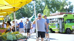 Weekend shopping at the Summer Farmers Market. Stock Footage
