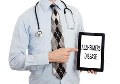 Doctor holding tablet - Alzheimers disease - stock photo