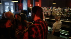 4K Bar staff working & young party crowd dancing in nightclub.  Stock Footage