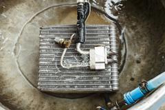 Car air conditioner condenser leaking check Stock Photos