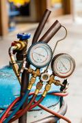 Refrigerant gas cylinder with manifold gauge Stock Photos