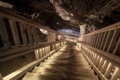 Salt miners stairs deep undeground - Wieliczka Salt Mine - stock photo