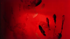 A short horror clip featuring bloody hands, eyes, and grunge textures. Stock Footage