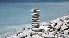 Stack of zen stones on the beach Stock Footage