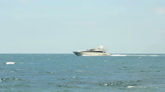 Luxury white speed yatch in open waters Stock Footage