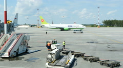View on runway in International Airport Pulkovo. One of aircrafts is taxing - stock footage