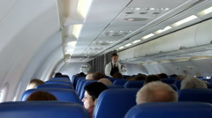 Interior of airplane with passengers on seats. Stock Footage