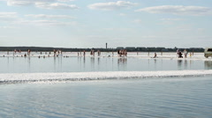 People rest at the exotic salt lake Baskunchak in Astrakhan oblast. Stock Footage