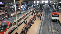 Travelers in Atocha station, Madrid, Spain Stock Footage