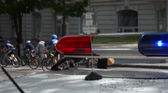 Road police car emergency lights during the cycling event Stock Footage