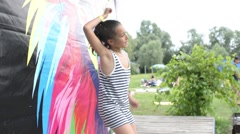 Young girl dancing fun in the summer park dressed T-shirt Stock Footage