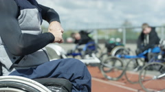 4K Smiling disabled athletics team warm up before training session at race track Stock Footage