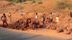 Unidentified people construction road in India - stock footage