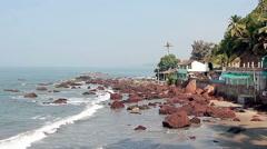 Rocks in the sea near Arambol beach in Goa Stock Footage