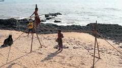 Unidentified Wandering tightrope walker playing on the beach Stock Footage