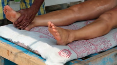 Close up of therapist's hands doing legs massage on woman. Stock Footage