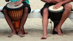 Man playing on drum at the Arambol beach Stock Footage
