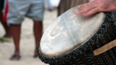 Man playing on drum at the Arambol beach. Stock Footage