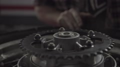 Man Puts a Motorcycles Wheel Bearing Stock Footage