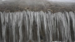 Clean fast flowing river water flowing over small concrete barrier make bubbles Stock Footage