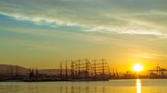 Sunset in the seaport of Novorossiysk with tall ships. Timelapse Stock Footage