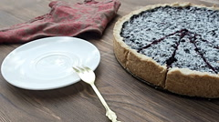 Blueberry pie sprinkle with powdered sugar , on the wood table - stock footage