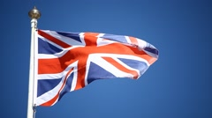 UK flag on a blue sky Stock Footage