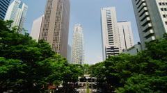 Camera Tilt up Sky Scrapers in Shinjuku West Stock Footage