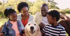 Portrait of cute family is smiling and sitting with a dog Stock Footage